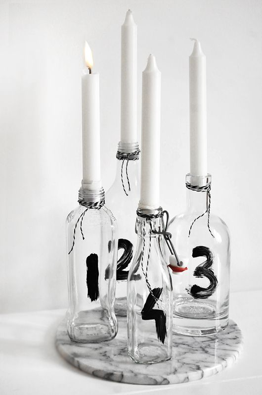 Candle holder DIY made of glass bottles ♥ (I'd change it up, instead of numbers something different, pretty paper maybe?)