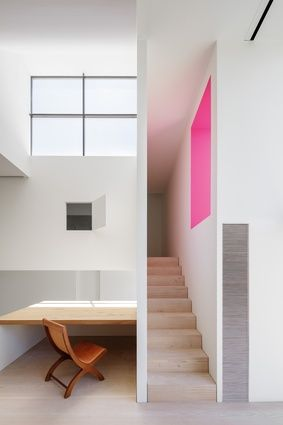 A narrow stair, concealed by internal walls, leads to the main bedroom.