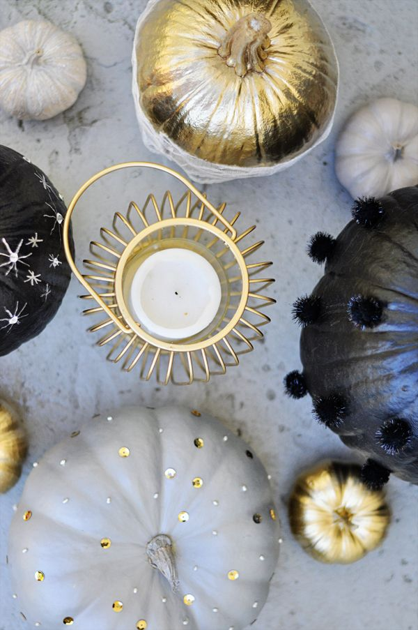 How to decorate pumpkins in a glam yet spooky color palette of black, neutrals and gold.