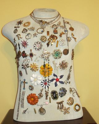 Mannequin used to display a pin collection. by Jeanette Janson