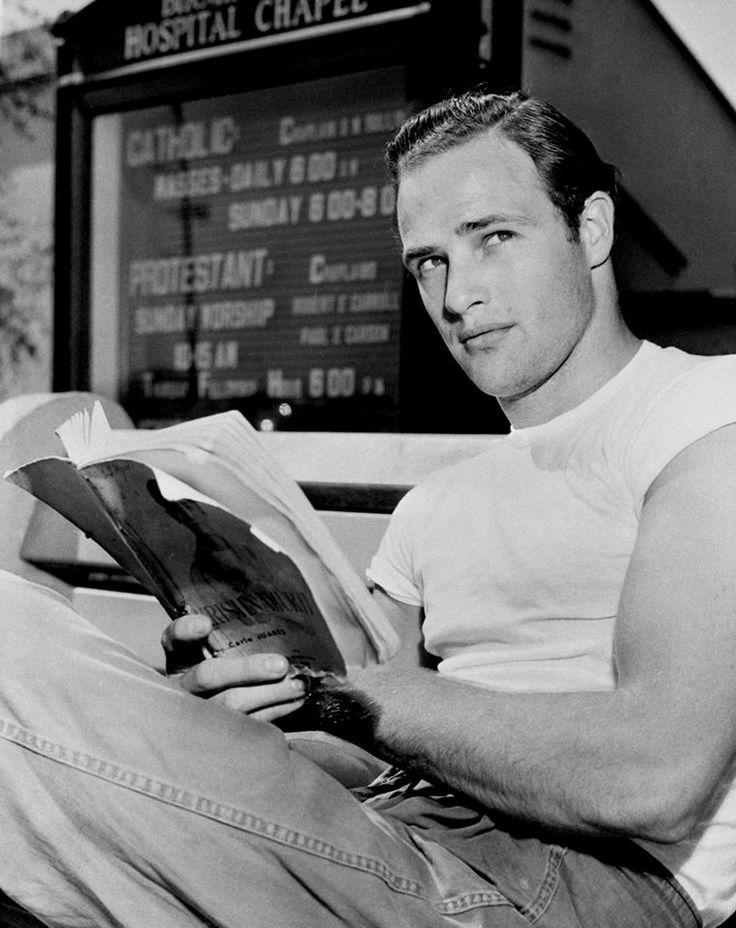 Marlon Brando Reading a magazine Black and white