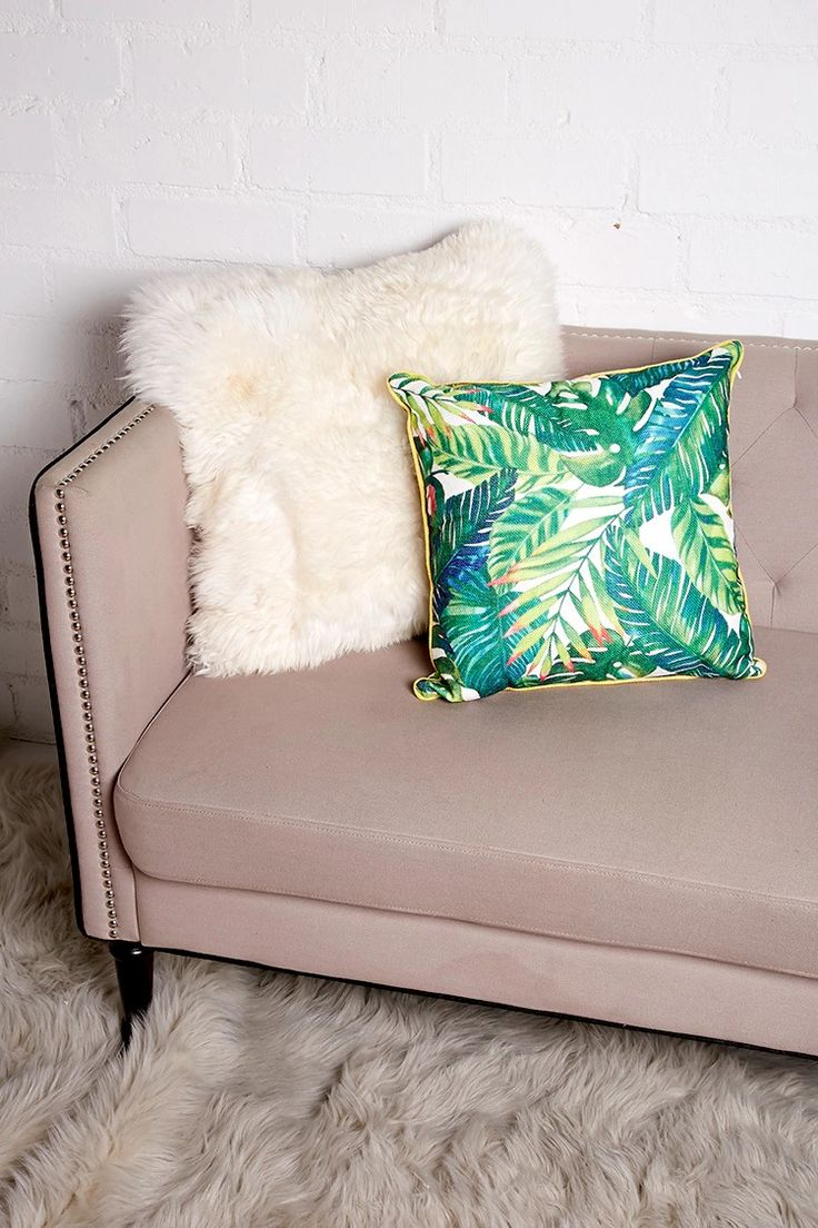 A woven pillow featuring an allover foliage print, a contrast trim, and a concealed side zipper.
