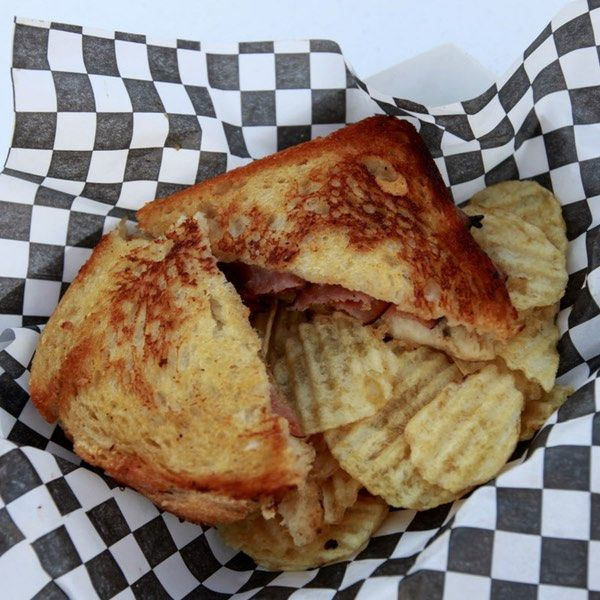 The defining characteristics of a grilled cheese sandwich might seem obvious: gooey, melted American slices clasped between c