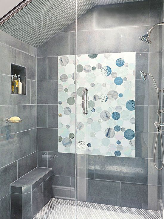 Fashion a stellar seat in your walk-in shower by opting for an unexpected profile accentuated with strategically positioned tiles.
