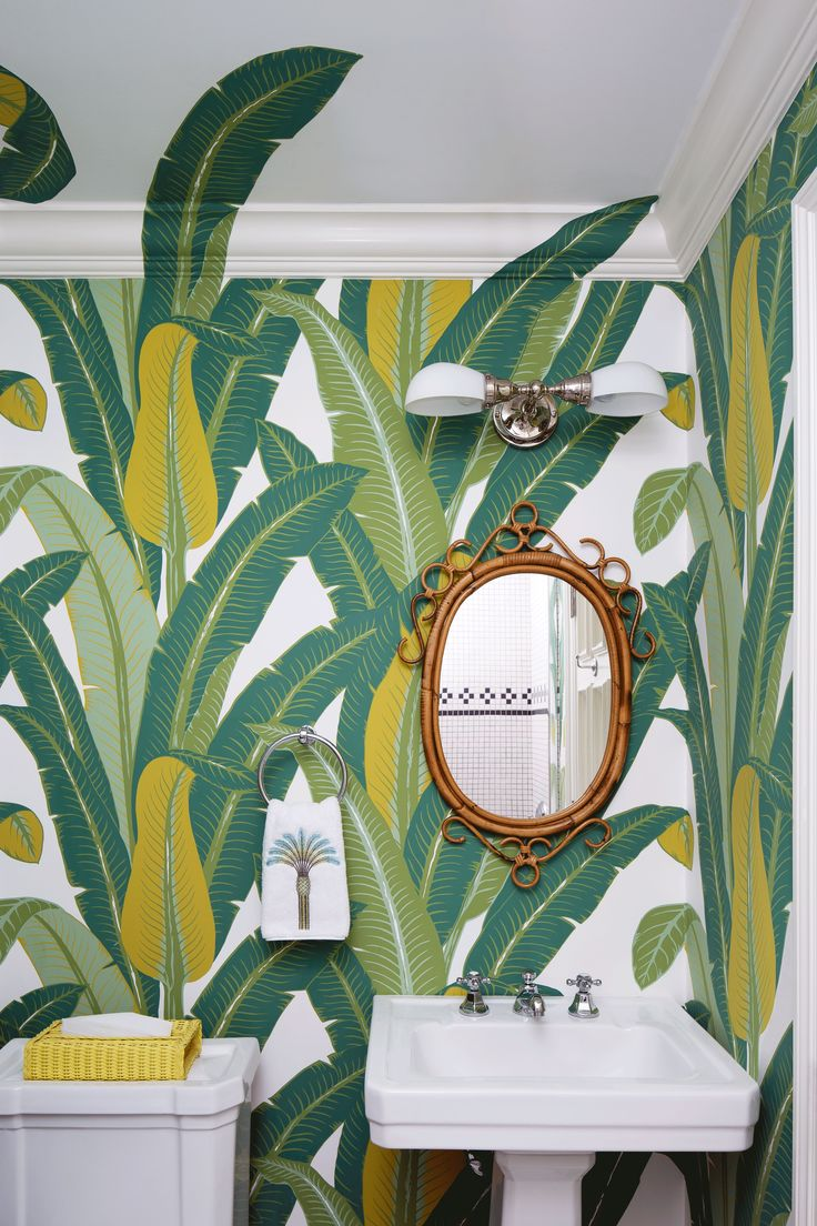 All other tropical bathrooms can step aside; we've found a winner. This Palm Beach guest bathroom may not be in the islands, but it sure feels like it, thanks to large-scale palm leaf wallpaper in rich golden yellows and dazzling emerald greens. A playful