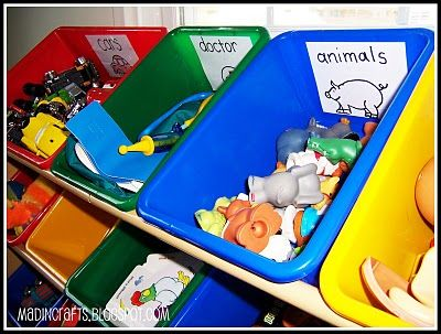 I have GOT to do this in our playroom!  Maybe those toys will actually be put away where they go.