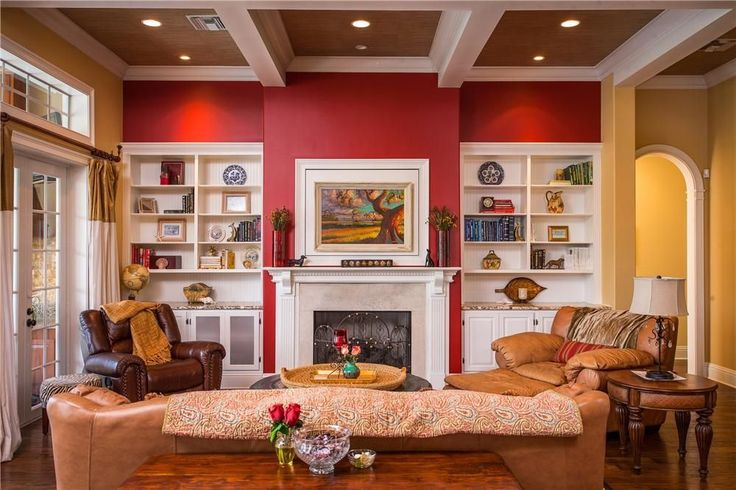 Eclectic Living Room with Built-in bookshelf, Crown molding, American leather savory recline chair, Box ceiling, French doors