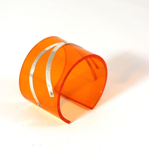Philippa Green orange perspex cuffs with silver strips