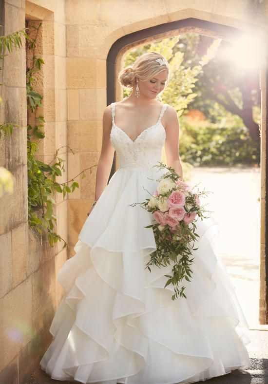 Figure-flattering fitted bodice and shoulder straps with hand-sewn Diamante beading, and a romantic skirt of layers and layers of ethereal tulle | Essense of Australia | https://www.theknot.com/fashion/d2073-essense-of-australia-wedding-dress
