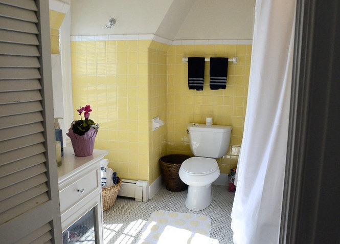 The bathroom gets a sunny yellow tile treatment at 550 Roberts Ave.,  Syracuse.