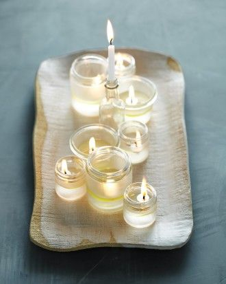 Try DIY Menorahs with Olive Oil Lights: Cover the top halves of 8 small jars with masking tape. Using etching cream, etch bottom halves according to product directions. Remove tape. Fill jars halfway with water. Add 1/8 inch olive oil. Drop a floating wick into each jar, cork side down. Use a birthday candle in a small, narrow-necked bottle for the shamash.