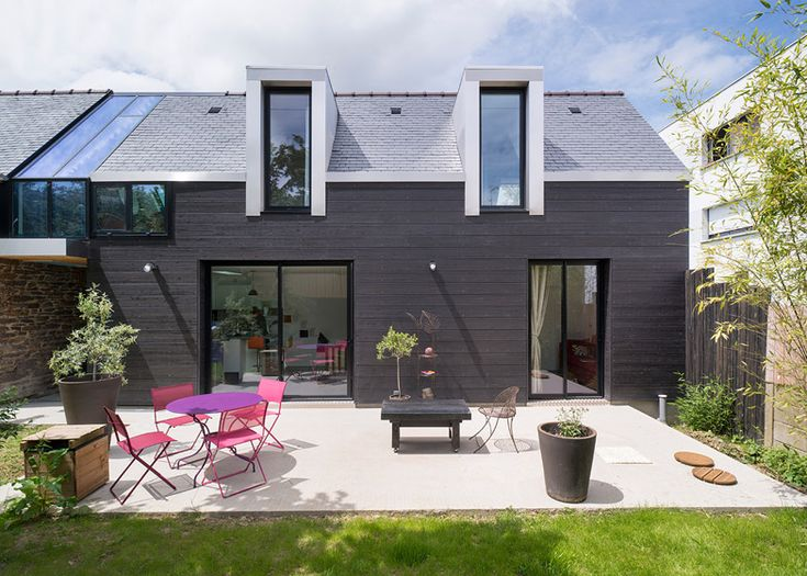 Extension built with modern materials to distinguish it from the adjoining brick house.