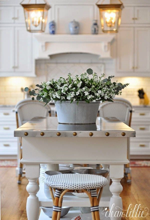 Fresh Farmhouse--Love the table top with the studs around the sides