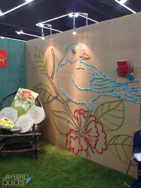 Wow.  Heather Bailey's bird at Quilt Market.  Love this idea for a wall.