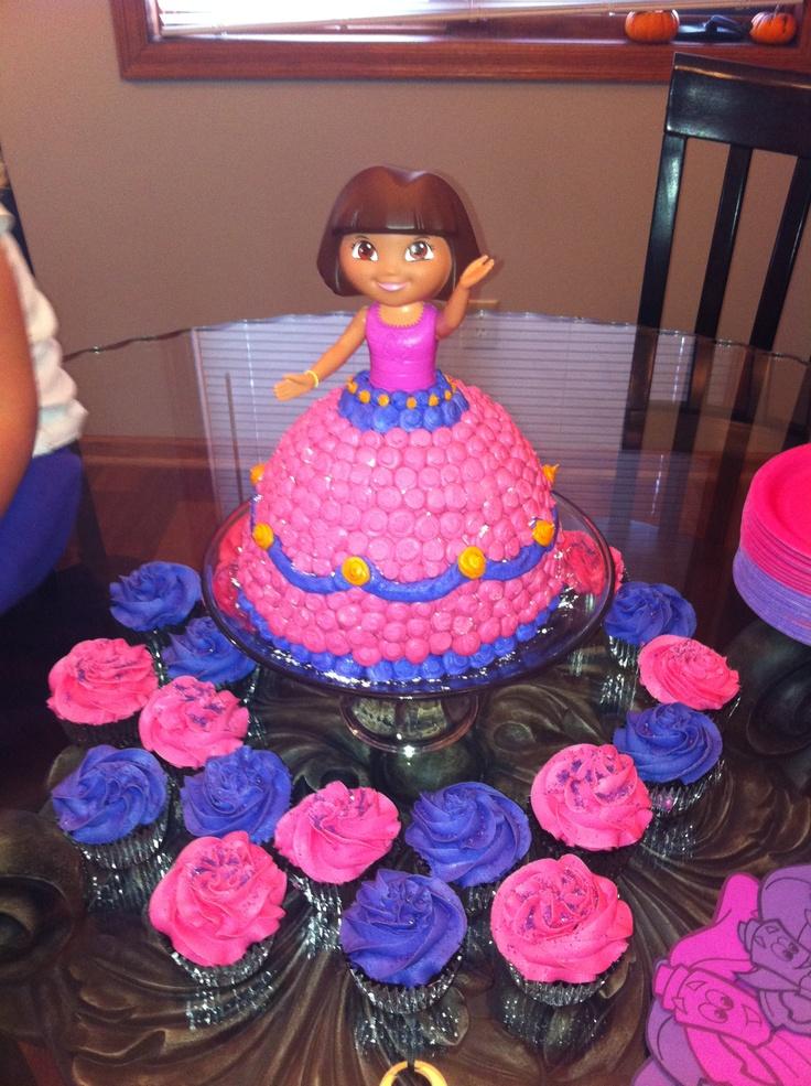 Dora birthday cake and cupcakes