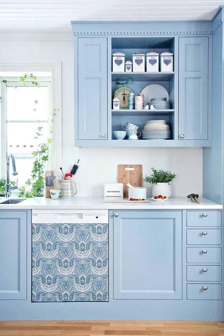 Cover an old dishwasher with matching wallpaper