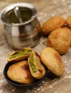 Dal, Baati and Churma – the combo is synonymous with Rajasthani cuisine. Here is a delicious Baked Masala Baati, made of whole wheat flour and stuffed with a flavourful green peas stuffing. The interesting twist here is that the baati is baked, reducing the oil requirement and also making it easy to prepare a whole batch at one go, without frying them one by one. Serve fresh off the oven with Panchmel Dal and Churma.