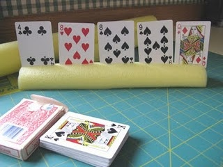 A cheap and easy card holder made from a pool noodle. Good idea to use with card games for math practice.