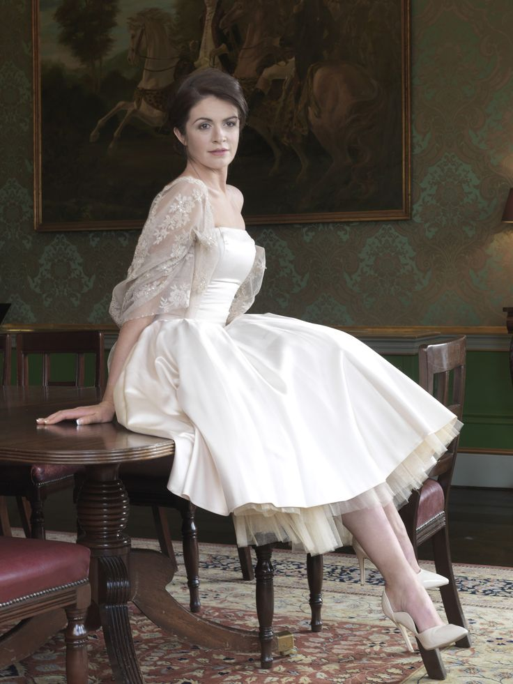 Ivory satin, knee length dress, with lace shawl, inspired by 1960s styling. Taken from 2015 wedding dress collection by Ginan Abbas. www.goldenstitch.ie
