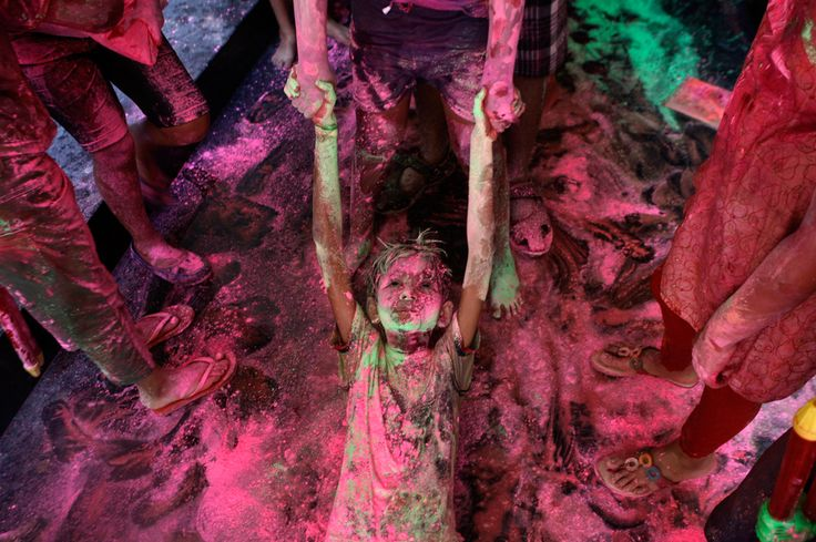 March 16, 2014 | An Indian boy drags another on the floor of an apartment as they play with colors during the Holi festival in Chennai, India. The festival also marks the advent of spring | Arun Sankar K / Associated Press | #photography #photojournalism