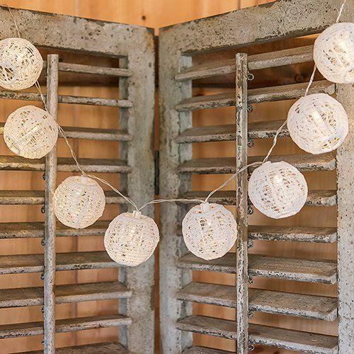 These lace lantern string lights are an easy way to add functional lighting and fashionable style to your romantic wedding look.