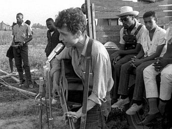 July 2, 1963: Bob Dylan at civil rights gathering in Greenwood, Mississippi singing 'Only a Pawn in Their Game,'