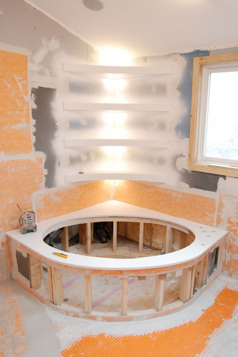 A lot going on here - Ceaserstone tub deck, Schluter Kerdi, Schluter Ditra, curved shelves, LED lights. Talk about custom.