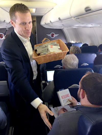 Eric Greitens, promoting his book Resilience, on a March 31st Southwest flight as part of the airline's Artist on the Fly in-flight entertainment program. - peoplewhowrite