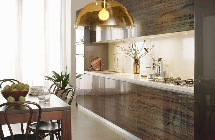Light toned glass splash back with high gloss timber look laminate.  Photo credit- laminex.com.au