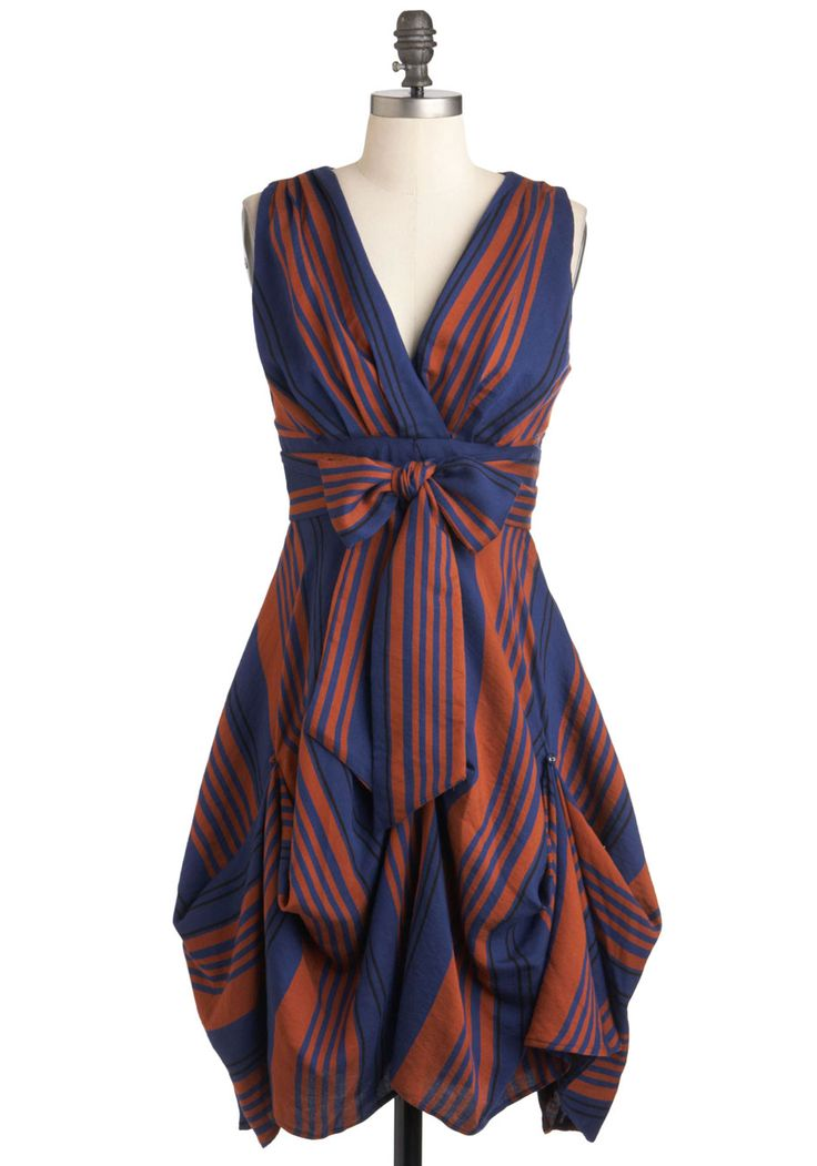 Ladies and gents, step right up to see the finest in festive fashion! With its earthy-orange and navy stripes and playful gathered silhouette, this Eva Franco dress - found exclusively at ModCloth - is game for browsing booths of souvenirs or a romantic ride on the Ferris wheel.