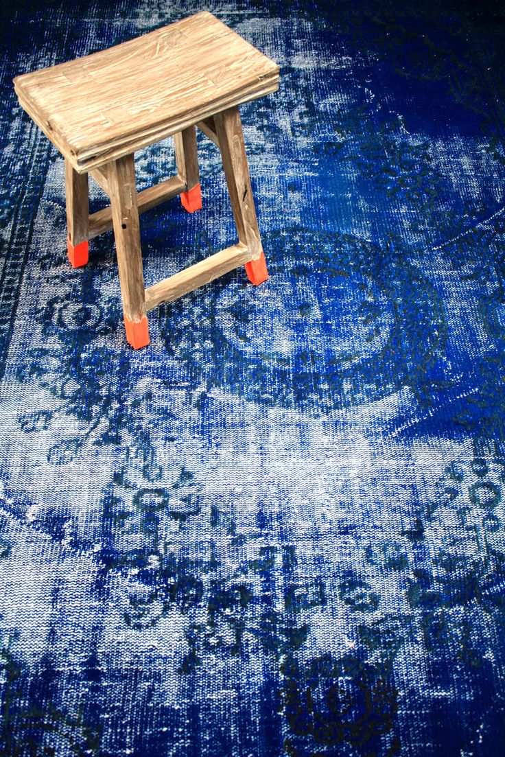 Orange & Indigo: stool with neon dip via HKliving.nl overdyed rug via brownbirds.com nice!