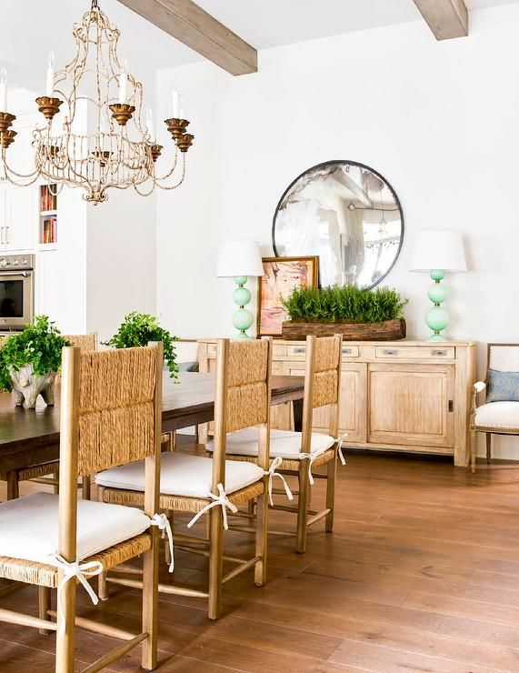 Rush Back Dining Chairs With White Tie Back Cushions Aligned At A Dark Brown Wood Dining Table Accen Wood Dining Room Dining Room Buffet Wood Dining Room Table
