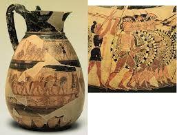 Olpe chigi; 640-630 a.C., Periodo arcaico; argilla depurata e dipinta; tumulo di Monte Aguzzo, Veio, Toscana, Italia; Museo di Villa Giulia, Roma. Gli olpe erano contenitori per il vino utilizzati durante i banchetti. Le immagini dipinte riproducono una storia ed avevano funzione decorativa. Il vaso era di produzione corinizia, come si può comprendere dalla ceramica gialla. Considerare anche la fonte: http://www.villagiulia.beniculturali.it/index.php?it/141/selezione-di-opere/15/olpe-chigi