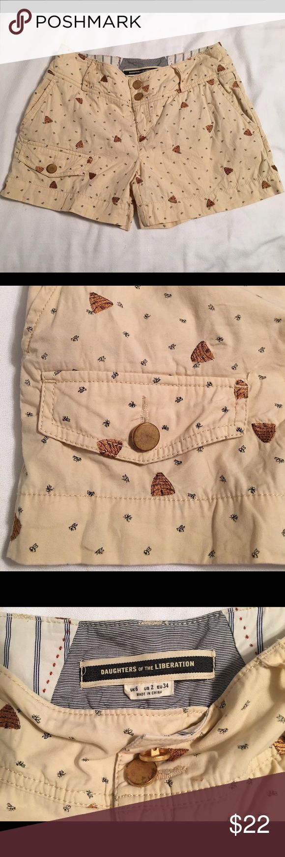 Anthropologie Daughters of the Liberation Shorts Anthropologie's Daughters of the Liberation shorts are embroidered with precious little bee hives. Has double buttons in the front with a cargo pocket & also has two back pockets. So so cute!!! Great condition! Anthropologie Shorts