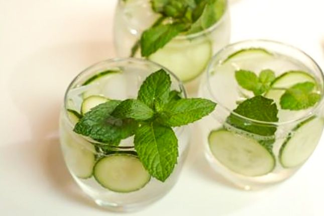 Add cucumber, mint, and basil to fizzy water to make this refreshing soda.
