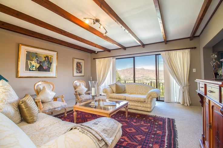 Its use of large windows throughout allows for the fantastic views of the out-stretching Paarl Valley up till the tall Drakenstein Mountains to always be seen.