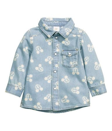 Patterned shirt in soft washed denim with a collar, snap fasteners at front, and a chest pocket with flap and snap fastener.