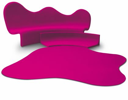 Looks like spilled fuchsia paint sofa and rug...very funky...Karim Rashid