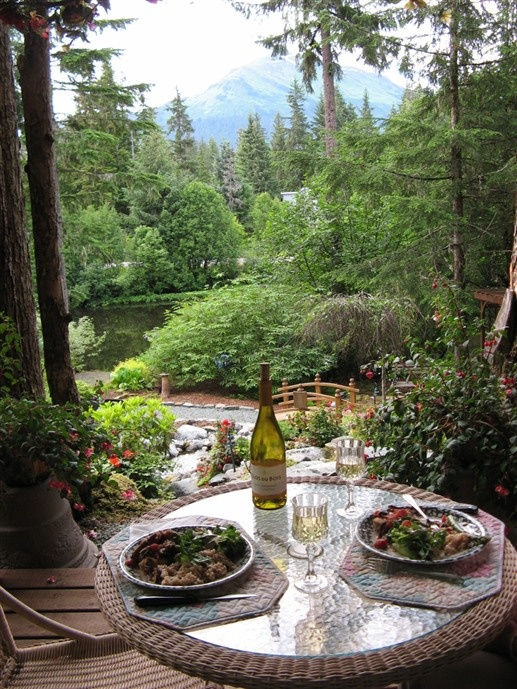 Dinner in the garden at Pearson's Pond Luxury Inn & Adventure Spa in Juneau, Alaska