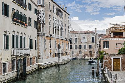 Canal with the boats and people in Venice , Italy , Europe.