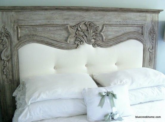 fireplace mantle repurposed into a headboard.......very romantic