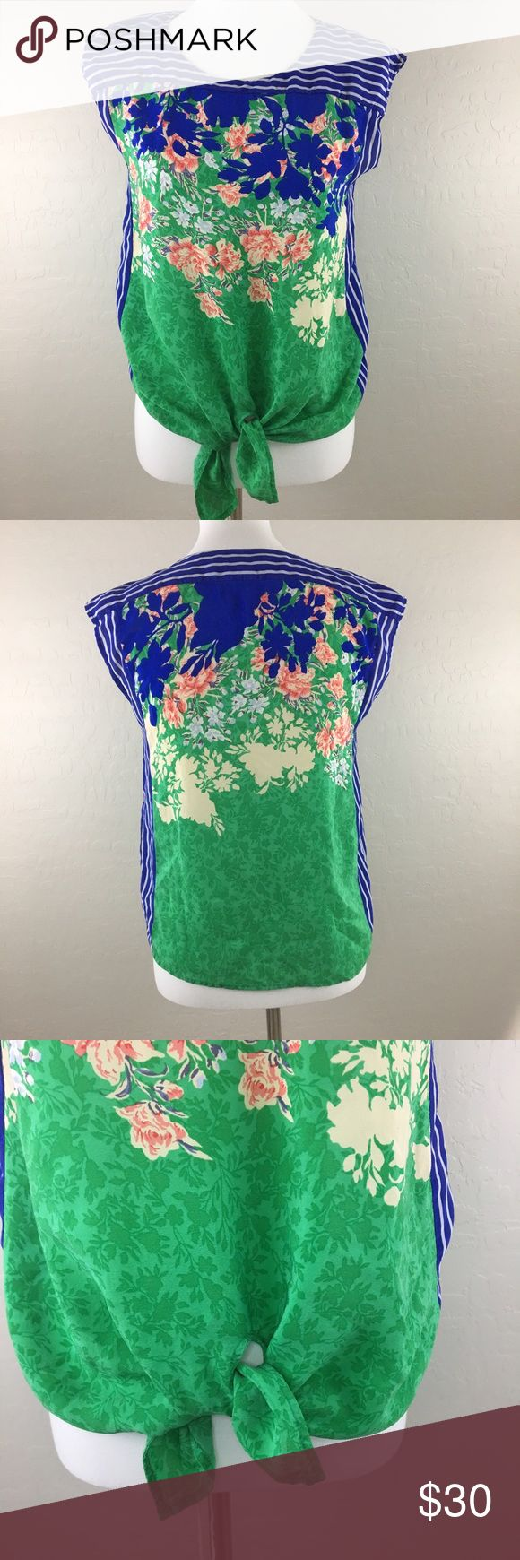 Anthropologie Silk Blouse by Moulinette Soeurs Pretty silk floral top by Moulinette Souers. Features a tie front waist. Gentle used condition. No noted flaws. Anthropologie Tops
