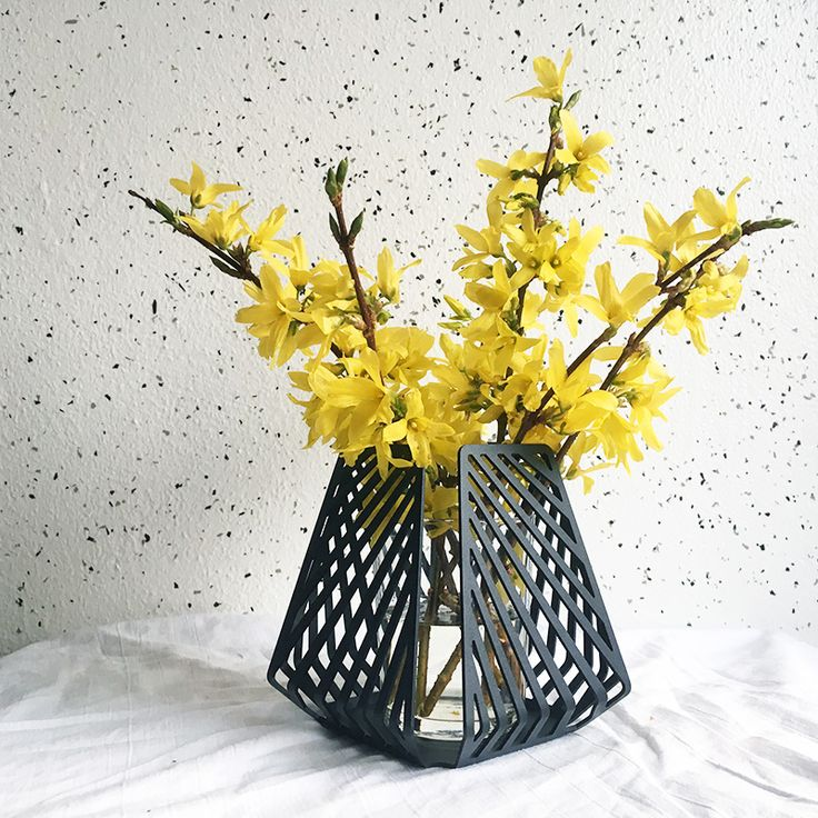 candle holder transformed into vase, styled with yellow forsythia branches picked in the wild