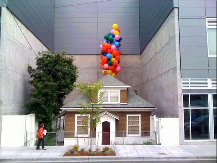 """In the Ballard neighborhood of Seattle, there's a huge shopping mall with a strange hole in the center of the building. Inside that gap sits a tiny house with an amazing story that some say inspired Pixar's UP."" » What a sweet story this is!"