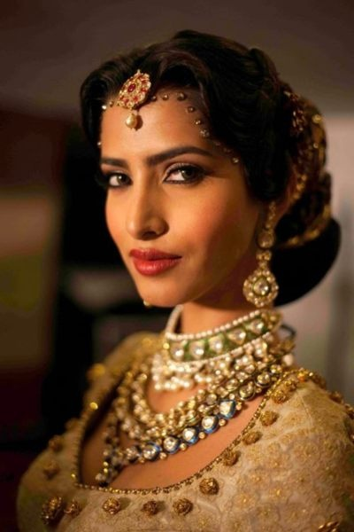 beautiful jewelery (and placement of tikkas to look like jewelery) Indian bridal jewels