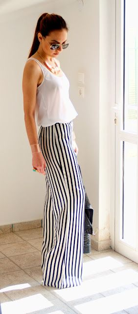 Ana's first outfit change after coming home Zara striped palazzo trousers. Ch 20
