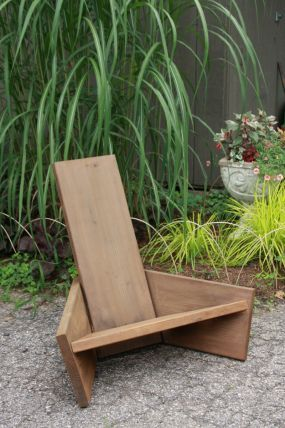 Modern take on an Adirondack chair. Taller, less harsh more comfortable angle