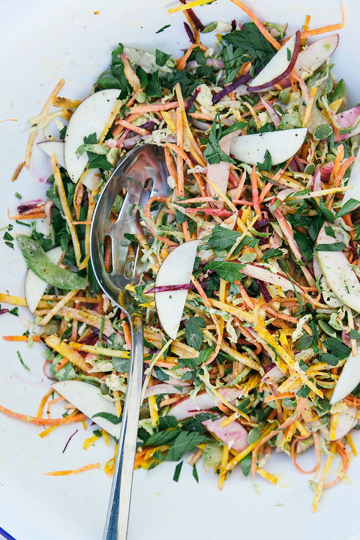 shredded brussels sprouts with garlic orange tahini dressing.