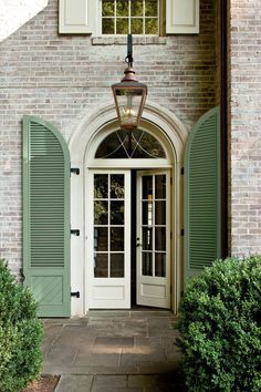 """Maximized the Stature - A Charming Restoration - Southernliving. """"Everything was done to give the house some height because the homes on either side loom over it,"""" says Jeremy. """"We tried to pick it up a bit."""" Paul and Jeremy created an oversize but not imposing 9-foot-tall limestone entryway. Light spills into the foyer through the 7-foot French doors and leaded-glass transom. A pair of Palladian-style shutters adds a single punch of color (Pratt"""