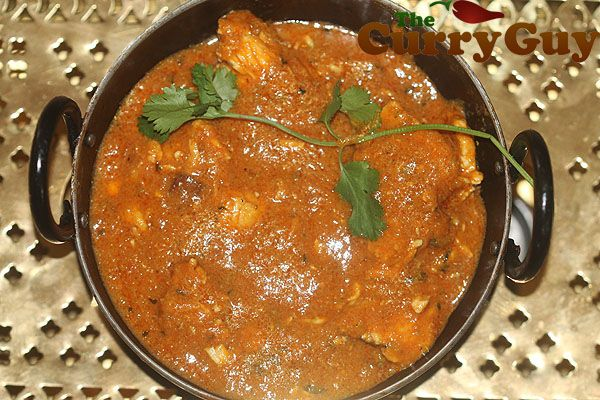 Chicken Tikka Masala Balti Recipe Main Course with chicken, ghee, garlic paste, ginger paste, onions, tomatoes, tomato paste, masala, garam masala, chicken stock, double cream, unsalted butter, coriander